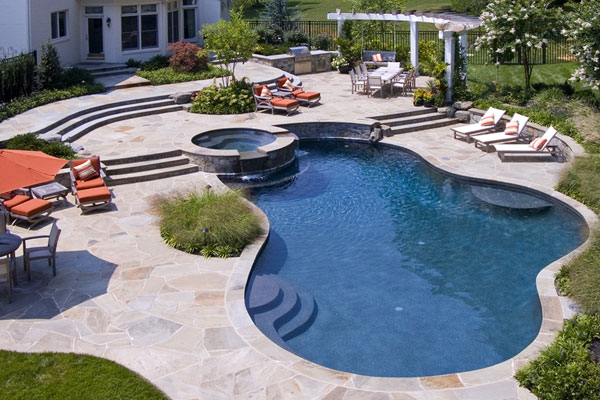 A Backyard With A Circular Shaped Pool